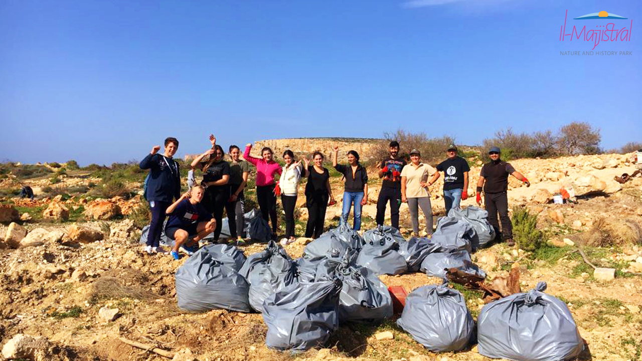 Volunteers cleaning up at Majjistral Park, Malta
